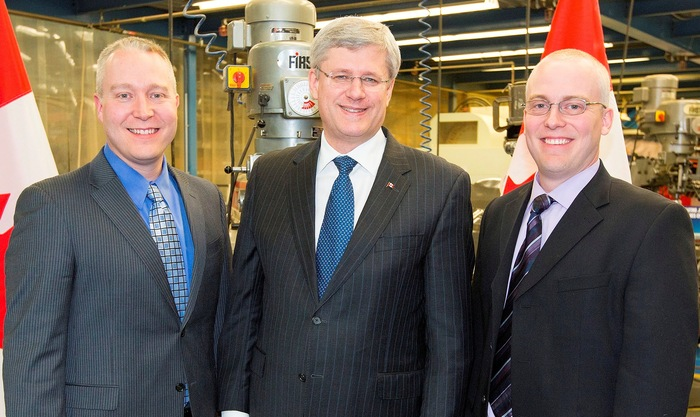 Owners of CPG Aerospace with PM Stephen Harper